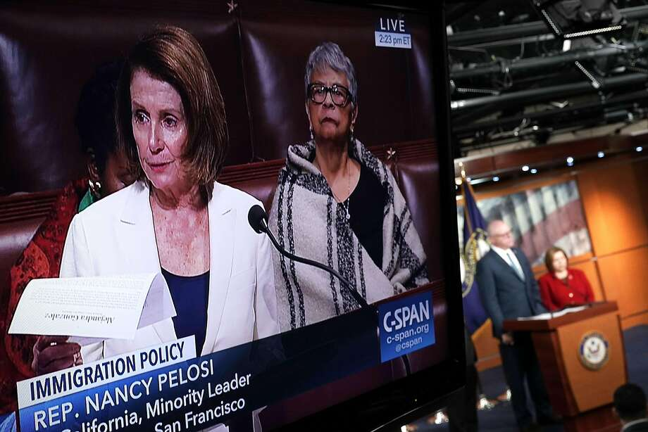 House Minority Leader Nancy Pelosi, D-San Francisco, is seen on a television screen (left) giving a filibuster-like speech on the House floor to demand a debate on legislation to protect young immigrants. Photo: Alex Wong, Getty Images