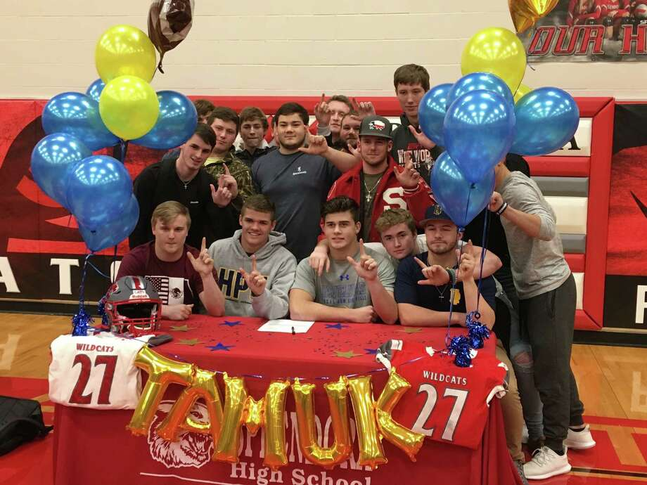 Splendora football player Adam Elliott, who signed with Texas A&-Kingsville, poses with his teammates during Signing Day at Splendora High School on Wednesday, Feb. 7, 2018. Photo: Rob Tate