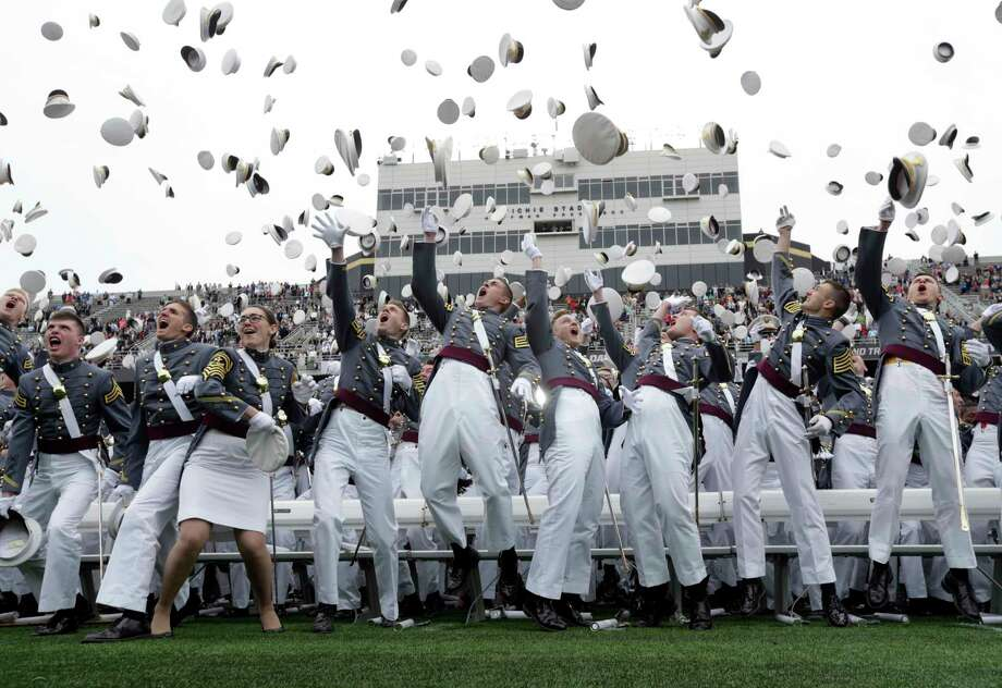 FILE - In this May 21, 2016, file photo, graduates toss their caps in the air at the end of a graduation and commissioning ceremony at the U.S. Military Academy in West Point, N.Y. The number of sexual assaults reported at the U.S. Military Academy roughly doubled during the last school year, according to data reviewed by The Associated Press, in the latest example of the armed forces' persistent struggle to root out such misbehavior. It's the fourth year in a row that sexual assault reports increased at the school in West Point. There were 50 cases in the school year that ended last summer, compared with 26 made during the 2015-2016 school year. By comparison, the U.S. Naval Academy in Annapolis, Md., and the U.S. Air Force Academy in Colorado Springs, Colo., saw only slight increases. (AP Photo/Mike Groll) Photo: Mike Groll, STF / Copyright 2018 The Associated Press. All rights reserved.