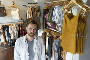 "Former ""Project Runway All Stars"" winner Anthony Ryan poses in his newly open women's fashion store, Couleur + Blindé, on Broadway near University of the Incarnate Word."