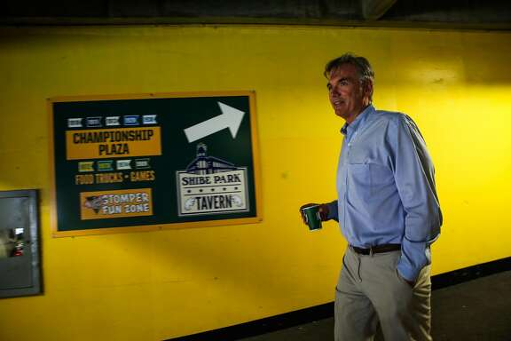 Billy Beane walks through the hallways of the Oakland Alameda County Coliseum during a portrait session in Oakland, Calif., on Monday, Aug. 14, 2017.