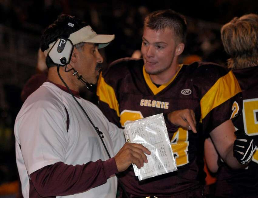 Colonie coach Mike Ambrosio talks with Alex Cook while coaching against Shaker. (Hans Pennink/Special to the Times Union)
