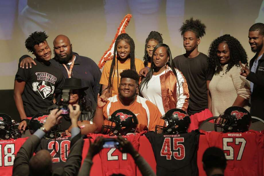 Family members of Keondre Coburn poses for a photo with family after signing with University of Texas in Austin football team on  Wednesday, Feb. 7, 2018, in Houston. ( Elizabeth Conley / Houston Chronicle ) Photo: Elizabeth Conley, Chronicle / Houston Chronicle / © 2018 Houston Chronicle