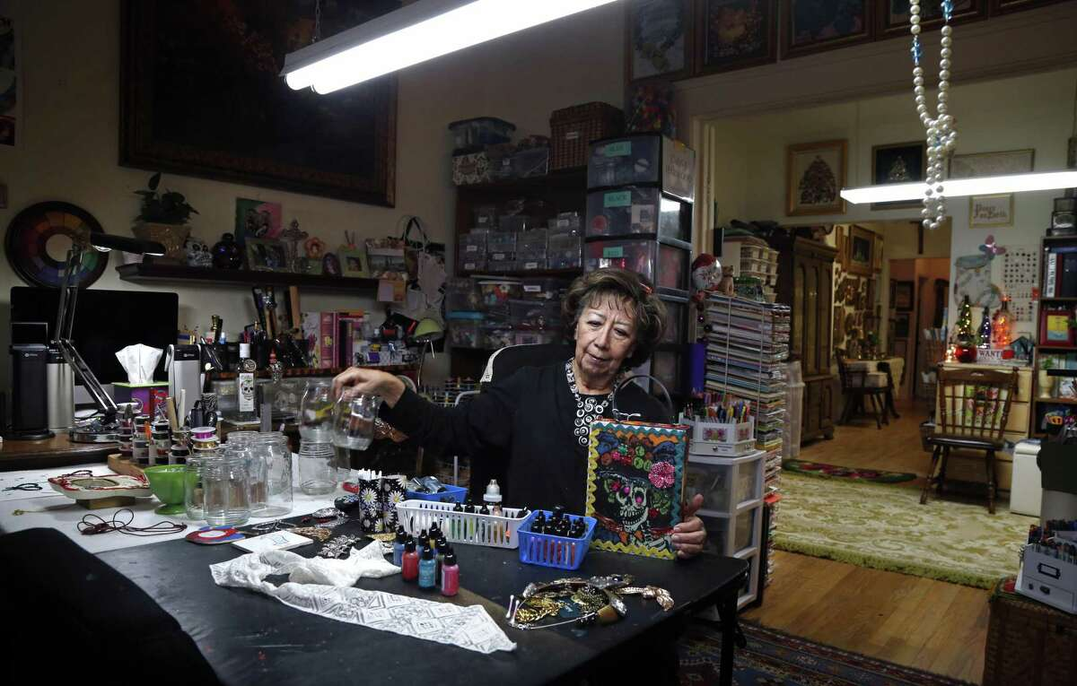 Diana Sanchez Harwood in her front room studio. The seldom used formal living room was turned into a beading room.
