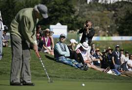 Bill Murray sits and watches Clint Eastwood make a long putt on the third green during the celebrity challenge event of the AT&T Pebble Beach National Pro-Am golf tournament Wednesday, Feb. 7, 2018, in Pebble Beach, Calif. (AP Photo/Eric Risberg)