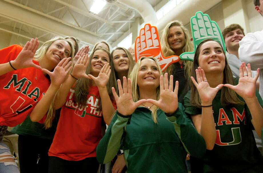 The Woodlands' Sophia Walls, second from bottom right, poses for a photo with friends after signing to play volleyball with Miami during a National Signing Day ceremony at The Woodlands High School, Wednesday, Feb. 7, 2018. Photo: Jason Fochtman, Staff Photographer / © 2018 Houston Chronicle
