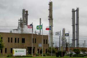 American, Texan and Brazilian flags fly outside a refinery owned by Petrobras, the Brazilian government's state-controlled oil producer, Tuesday, Oct. 20, 2015, in Pasadena. Petrobras paid more than $1 billion to buy the refinery from Pasadena Refining Systems Inc. in a series of transactions dating to 2006, a much higher price tag than the $42 million Astra Oil paid a year before. There is an ongoing criminal probe into the Pasadena deal as part of a larger Brazilian investigation into Petrobras transactions and allegations of bribery.  (Michael Ciaglo / Houston Chronicle)