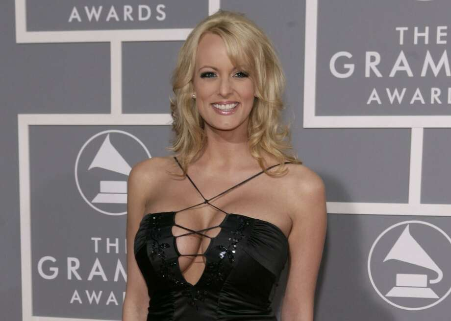 Porn starStormy Daniels, alleged to have an affair with Donald Trump before the 2016 presidential election, arrives for the 49th Annual Grammy Awards. She has apparently gained entree into the Hollywood glitterati — a stark contrast to the life our real heroes lead as members of the military. Photo: Matt Sayles /Associated Press / Sayles