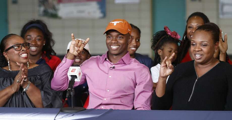 Anthony Cook of Lamar, one of the state's top football recruits, makes his announcement that he will be attending The Univeristy of Texas during a live televised announcement at Lamar High School, Wednesday, Dec. 20, 2017, in Houston.   ( Karen Warren / Houston Chronicle ) Photo: Karen Warren/Houston Chronicle