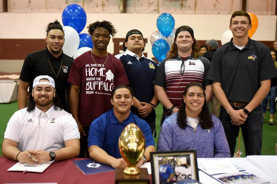 Top row, from left, Grant Brown, Elijah Prince, Stephen Quiroz, Cormac Fish, Tyler Madrid, bottom row from left, Mason Sanchez, Kougar Rodriguez, and Isaiah Nunez pose for a group photo during a Lee football college signing Feb. 7, 2018, at the Lee fieldhouse. James Durbin/Reporter-Telegram Photo: James Durbin