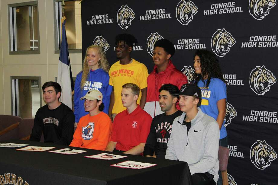 Nine student-athletes at Conroe High School signed their National Letters on Intent on Wednesday. Photo: Jon Poorman
