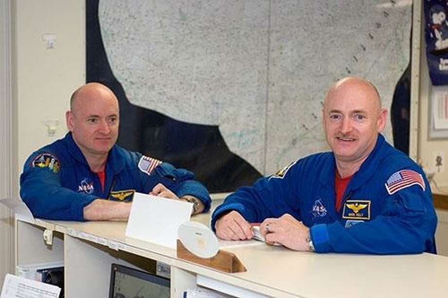 Astronauts Mark Kelly (right and Scott Kelly are pictured in the check-out facility at Ellington Field near NASA's Johnson Space Center. During Scott Kelly's time on the space station, NASA tracked both brothers' vitals and body changes. Photo: Houston Chronicle File Photo / Internal