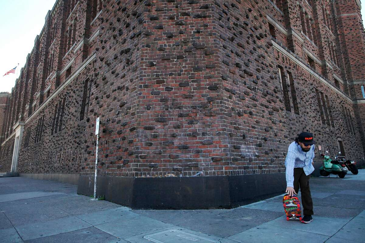 Matt Derrick, 40, rides his skateboard past The Armory on 1800 Mission St. April 2, 1014 in San Francisco, Calif.