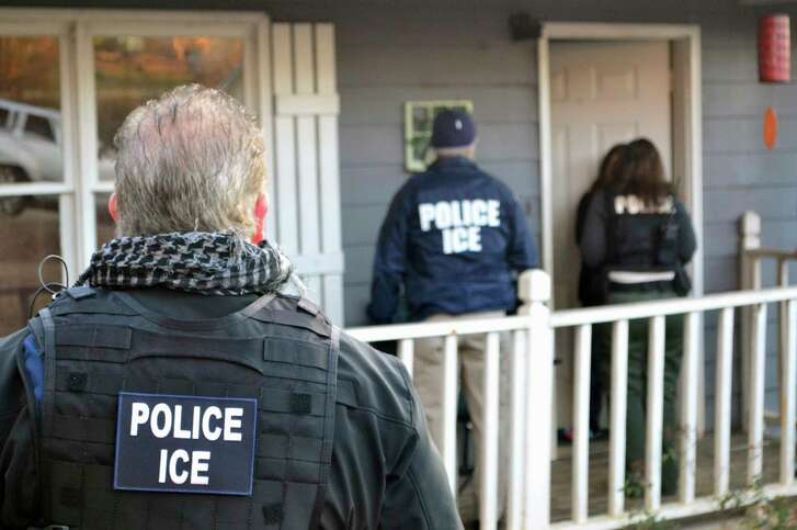 U.S. Immigration and Customs Enforcement, ICE agents arrive at a home in Atlanta Feb. 9, 2017, during a targeted enforcement operation aimed at immigration fugitives, re-entrants and at-large criminal aliens. (Bryan Cox/ICE via AP)