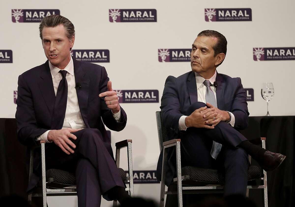Democratic Candidates for California Governor Gavin Newsom, left, speaks next to Antonio Villaraigosa at a NARAL Pro-Choice California event in San Francisco, Tuesday, Jan. 30, 2018. (AP Photo/Jeff Chiu)