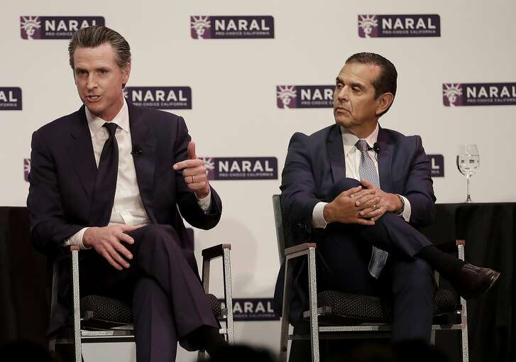 Democratic Candidates for California Governor Gavin Newsom, left, speaks next to Antonio Villaraigosa at a NARAL Pro-Choice California event in San Francisco, Tuesday, Jan. 30, 2018. (AP Photo/Jeff Chiu)