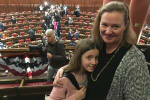 Brooke Cheney, a firearms shooting and safety school owner from Harwinton, brought her 10-year-old daughter, Nadia, to the Capitol Wednesday to hear Malloy's speech on Feb. 7, 2018.