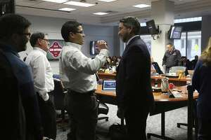 District 1 Councilman Roberto C. Trevino (right) chats with Central Electric's Chris Martinez before a briefing to City Council on a proposal for a newly updated communications system for Fire, Police and City Public Service during a B Session meeting on Wednesday, Feb. 7, 2018. The contract for the city's update to public safety's communication system is valued at $100 million is down to two companies: Central Electric and Dailey-Wells. The council will vote to approve either contractor on February 15. (Kin Man Hui/San Antonio Express-News)