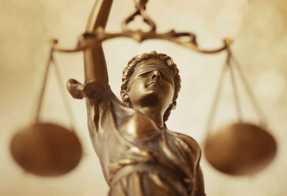 close-up scales of justice Photo: Fry Design Ltd. / Getty Images