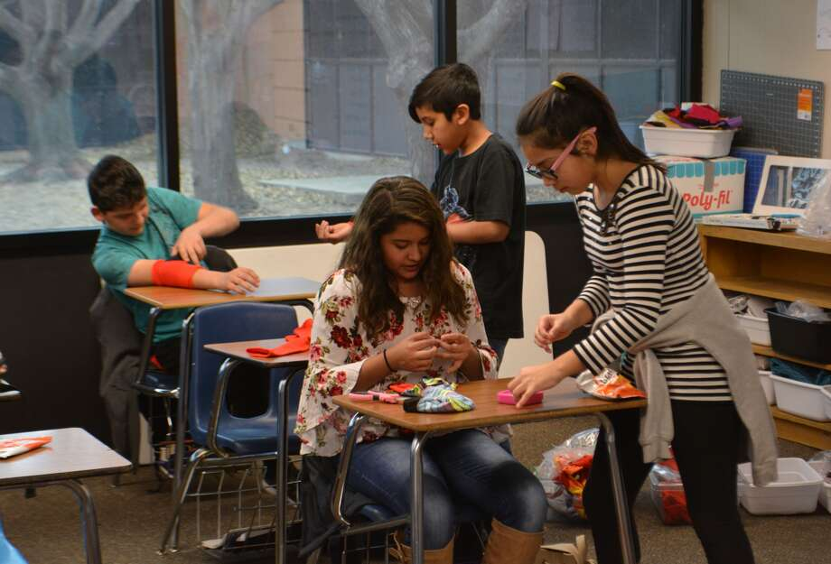 Students at Estacado Middle School discuss and design their own sock puppets during a Afterschool Centers on Education sewing club program Tuesday afternoon. Photo: William Carroll, Plainview Herald