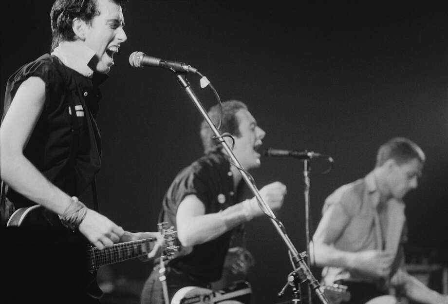 British punk group The Clash, performing in New York, September 1979. Left to right: Mick Jones, Joe Strummer (1952 - 2002 and Paul Simonon. (Photo by Michael Putland/Getty Images) Photo: Michael Putland/Getty Images