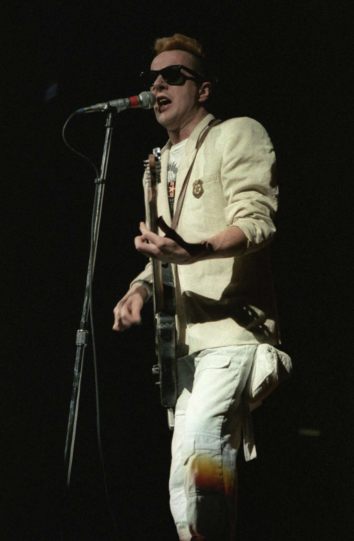 ST. PAUL, MN - MAY 15: Joe Strummer of the punk rock band The Clash performs at the St. Paul Civic Center in St. Paul, Minnesota on May 15, 1984. (Photo by Jim Steinfeldt/Michael Ochs Archives/Getty Images)