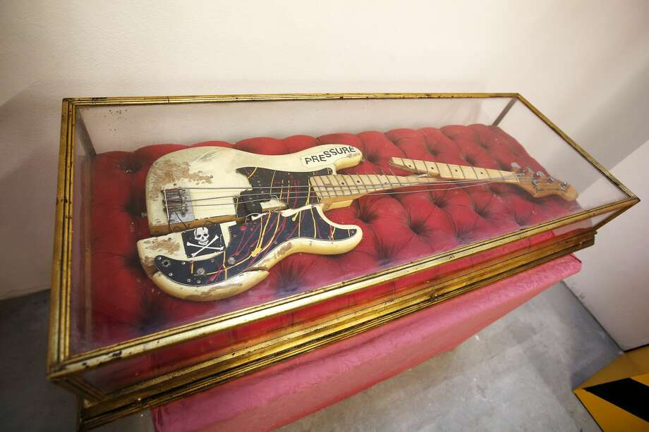 The remains of the Fender Precision electric bass guitar which was immortalised on the cover photograph of The Clash's album 'London Calling' on display at Black Market Clash pop-up exhibition and store in Soho to mark the release of the group's remastered collected works Sound System box set and new best of collection, Hits Back.   (Photo by Jonathan Brady/PA Images via Getty Images) Photo: Jonathan Brady - PA Images/PA Images Via Getty Images