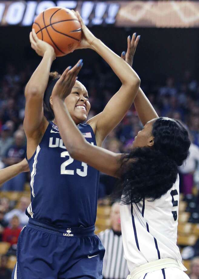 Connecticut's Azura Stevens (23) looks to shoot over UCF's Masseny Kaba at CFE Arena in Orlando, Fla., on Wednesday, Feb. 7, 2018. (Stephen M. Dowell/Orlando Sentinel/TNS) Photo: Stephen M. Dowell / TNS / Orlando Sentinel