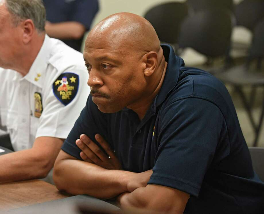 Aaron Collington, president of the Troy Police Benevolent Associatio, listens as Troy Police Chief John Tedesco speaks to the city council about the spate of shootings and fires that have plagued the city in recent weeks on Monday, July 24, 2017 at Troy City Court in Troy, N.Y. (Lori Van Buren / Times Union) Photo: Lori Van Buren / 20041113A