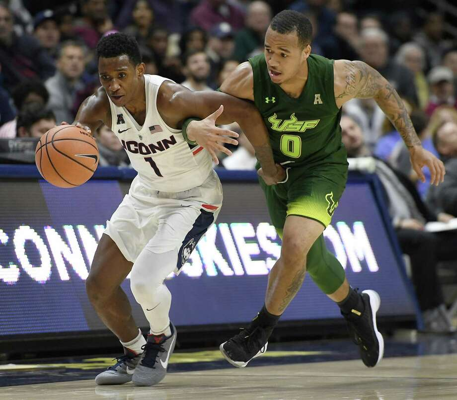 South Florida's Stephan Jiggetts, right, tangles with Connecticut's Christian Vital during the second half an NCAA college basketball game, Wednesday, Feb. 7, 2018, in Storrs, Conn. (AP Photo/Jessica Hill) Photo: Jessica Hill / Associated Press / AP2018