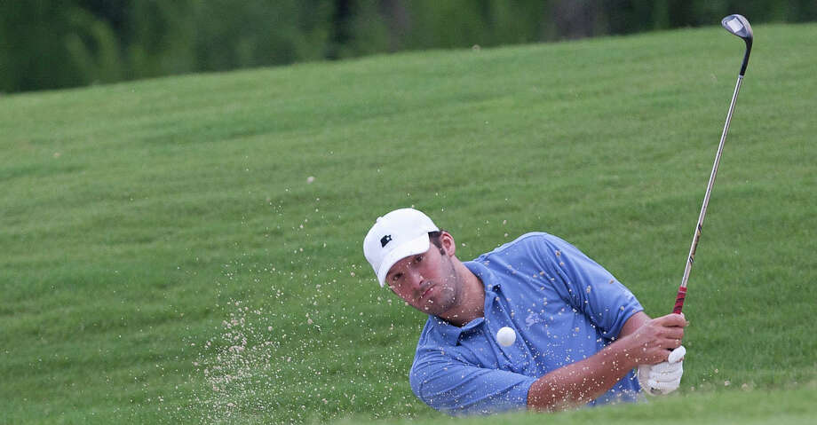 Dallas Cowboys quarterback Tony Romo hits out of the bunker on the fourth hole during sectional qualifying for the 2010 U.S. Open golf tournament Monday at The Club at Carlton Woods in The Woodlands. Photo: Eric S. Swist/Staff Photo By Eric S. Swist