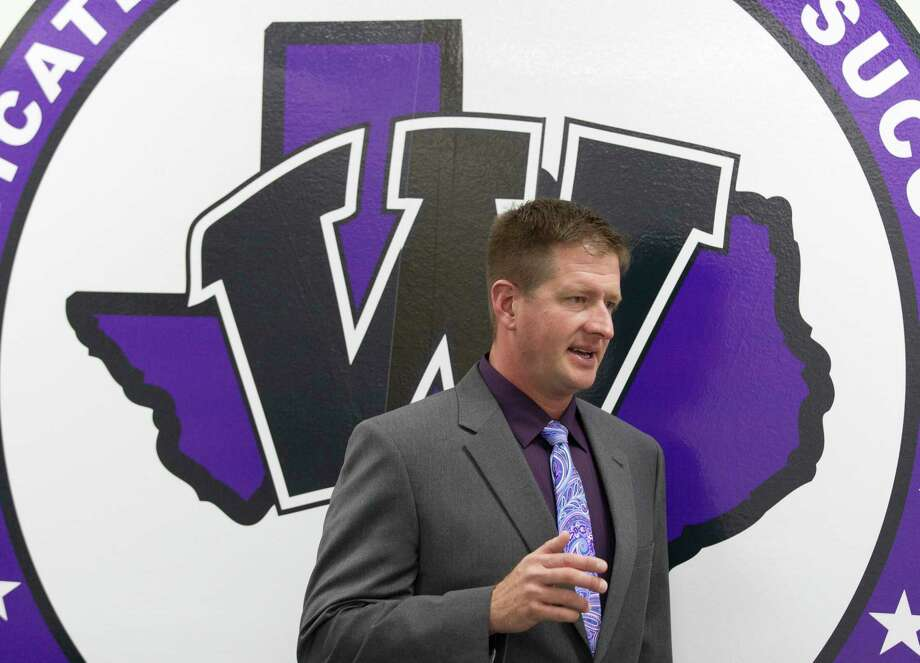 Michael Wall, former offensive coordinator at Lake Travis High School, is seen after being announced as Willis High School's new athletic coordinator and football coach, Wednesday, Feb. 7, 2018, in Willis. Photo: Jason Fochtman, Staff Photographer / © 2018 Houston Chronicle