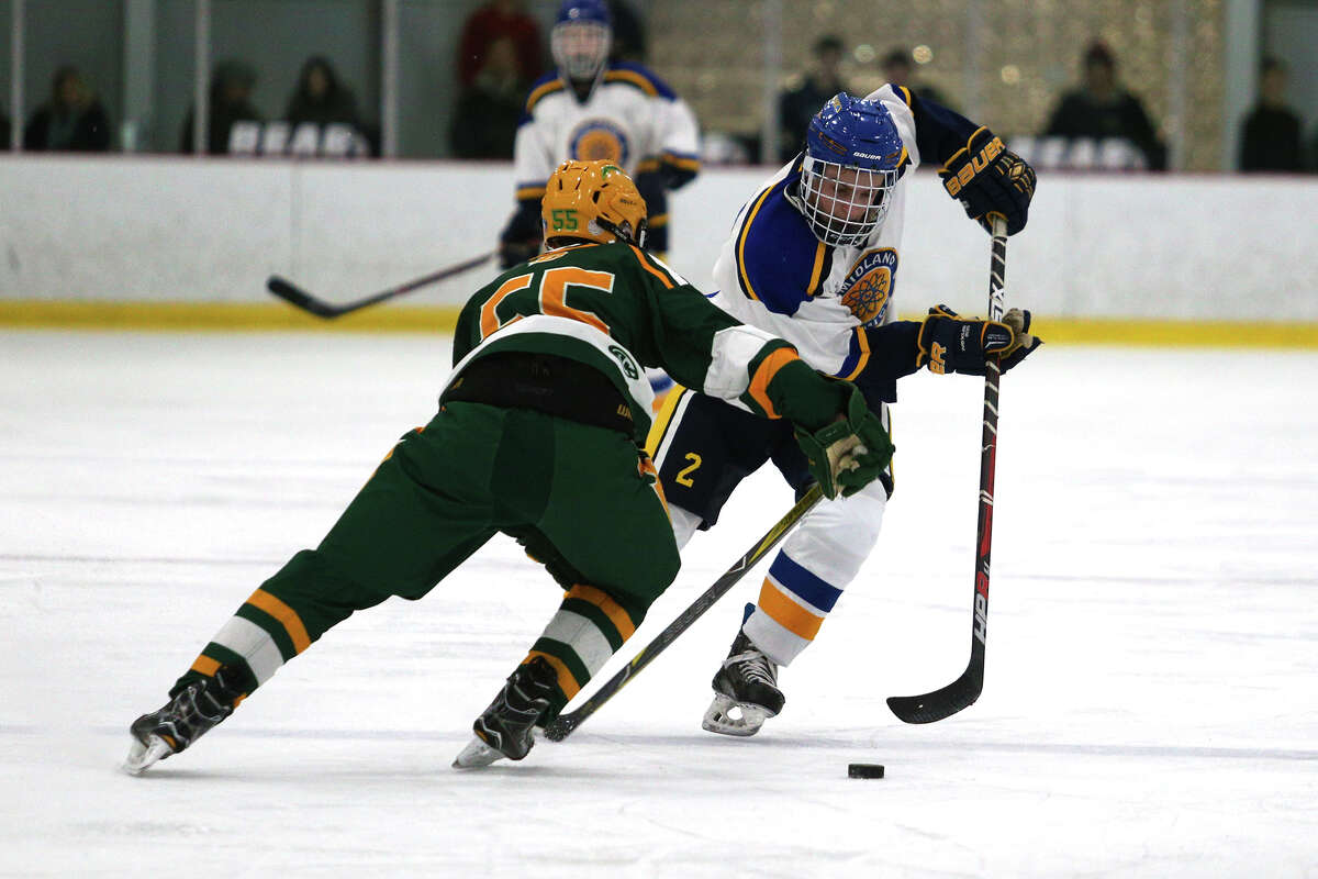 Midland's Matthew Babinski (2) carries the puck down the ice during the Chemics' game against Dow on Wednesday, Feb. 7, 2018 at Midland Civic Arena. (Samantha Madar/for the Daily News)