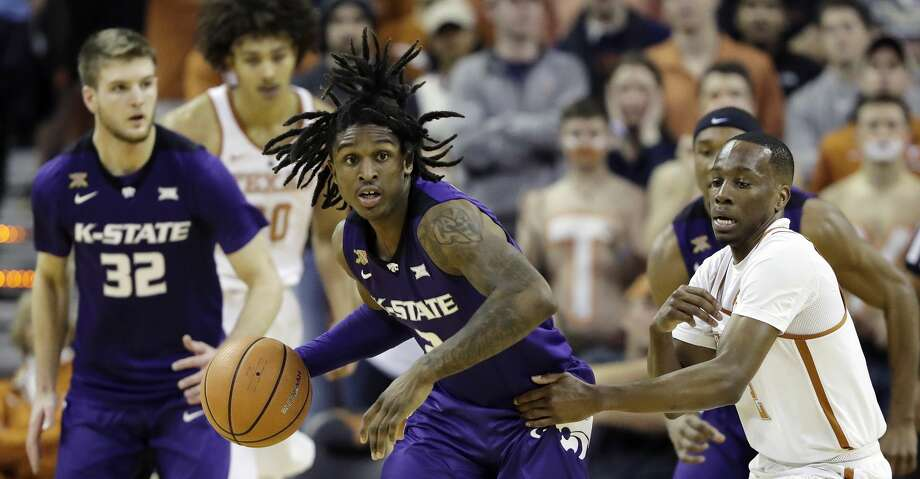 Kansas State guard Cartier Diarra, center, steals the ball from Texas guard Matt Coleman, right, during the first half of an NCAA college basketball game Wednesday, Feb. 7, 2018, in Austin, Texas. (AP Photo/Eric Gay) Photo: Eric Gay/Associated Press