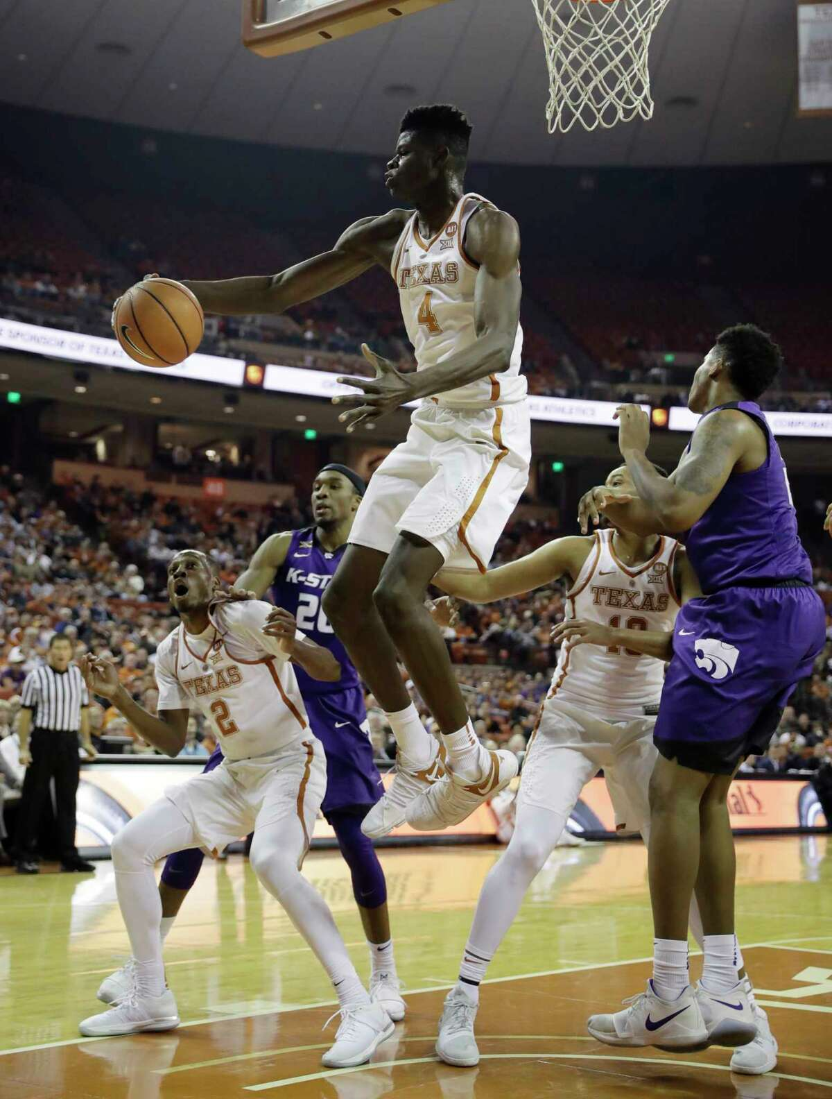 Texas forward Mohamed Bamba (4) grabs a rebound during the first half of an NCAA college basketball game against Kansas State, Wednesday, Feb. 7, 2018, in Austin, Texas. (AP Photo/Eric Gay)