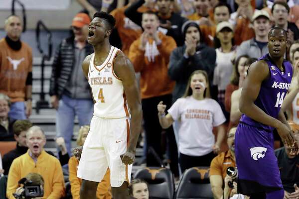 Texas forward Mohamed Bamba (4) reacts after he scored against Kansas State forward Makol Mawien (14) and was fouled on the play during the first half of an NCAA college basketball game Wednesday, Feb. 7, 2018, in Austin, Texas. (AP Photo/Eric Gay)