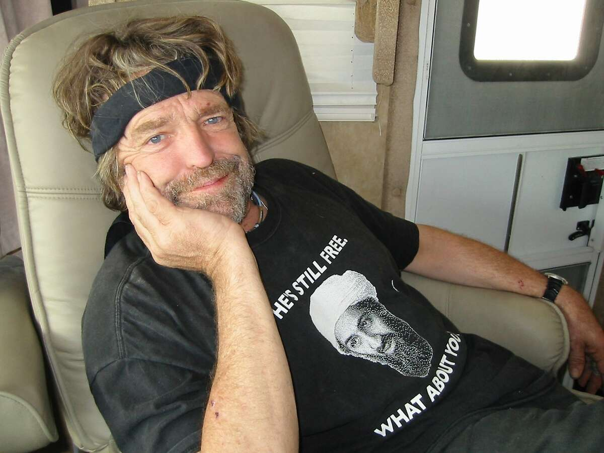 John Perry Barlow, former lyricist for the Grateful Dead and founding member of the Electronic Frontier Foundation, poses in his RV at Burning Man in August 2007 in Black Rock City, Nev.