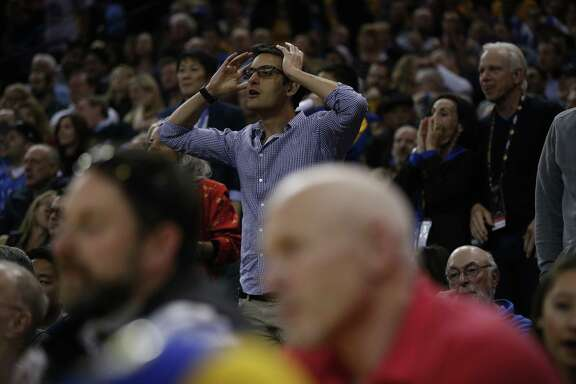 Spectators react to a foul against the Warriors during the second half of an NBA game between the Warriors and Oklahoma City Thunder at Oracle Arena, Tuesday, Feb. 6, 2018, in Oakland, Calif. The Warriors lost 105-125.