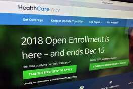 In this Dec. 15, 2017 photo, the HealthCare.gov website is photographed in Washington. A new tally by The Associated Press finds that nearly 11.8 million Americans have signed up for coverage this year under former President Barack ObamaÂ?'s health care law. ThatÂ?'s only about 3 percent less than last year, remarkably stable despite President Donald TrumpÂ?'s repeated efforts to repeal or undercut the program. The Affordable Care Act offers subsidized private health insurance to people who donÂ?'t have coverage on the job. (AP Photo/Jon Elswick