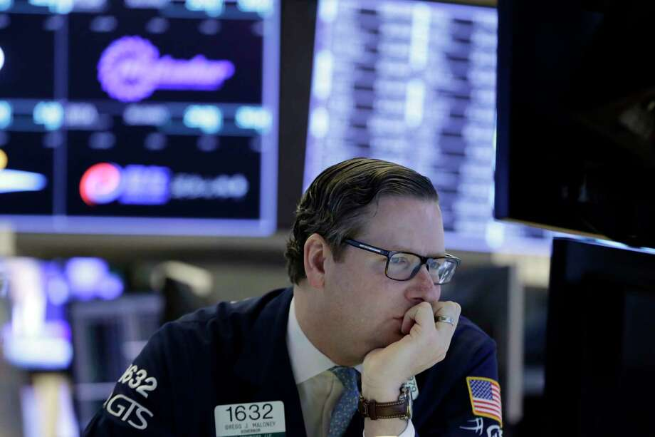 Specialist Gregg Maloney works at his post on the floor of the New York Stock Exchange, Wednesday, Feb. 7, 2018. Stocks are opening modestly higher on Wall Street as the market stabilizes following three days of tumult. (AP Photo/Richard Drew) Photo: Richard Drew, STF / AP
