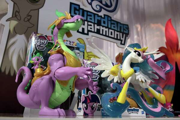 "FILE- In this Oct. 6, 2016, file photo, a pair of My Little Pony ""Guardians of Harmony"" characters, from Hasbro, appear on display at the annual TTPM Holiday Showcase, in New York. Toy maker Hasbro Inc. delivered a surprise sales drop for the critical fourth quarter as it struggled with lagging sales of ""Star Wars"" toys and Toys R Us's woes. The results, announced Wednesday, Feb. 7, 2018, underscore the challenges for  toy makers as they wrestle with a shift in buying habits.  (AP Photo/Richard Drew)"