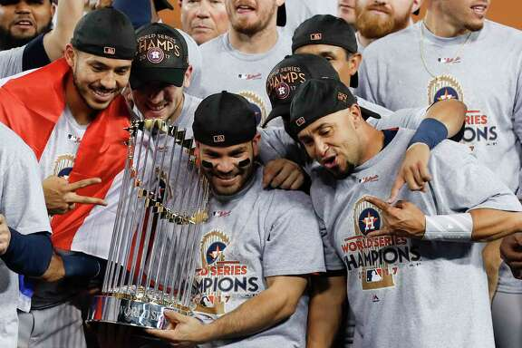 Reigning AL Most Valuable Player Jose Altuve, center, and the Astros could easily get used to holding the World Series trophy, as they did after last year's Game 7 victory over the Dodgers.
