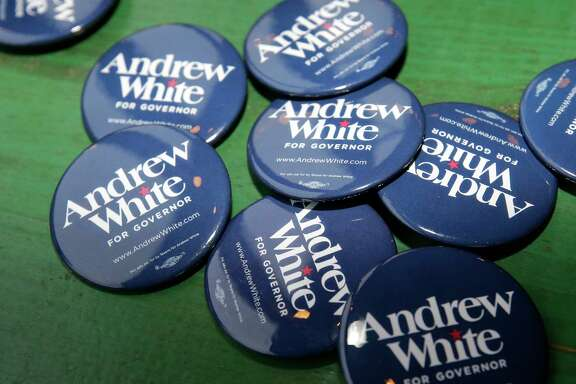 Campaign buttons for Andrew White, a Democratic candidate running for governor of Texas, are shown during event at Kirby Ice House, 3333 Eastside St., Wednesday, Feb. 7, 2018, in Houston.