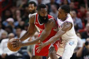 Houston Rockets guard James Harden, left, looks for an open teammate past Miami Heat guard Josh Richardson during the second half of an NBA basketball game, Wednesday, Feb. 7, 2018, in Miami. The Rockets defeated the Heat 109-101. (AP Photo/Wilfredo Lee)