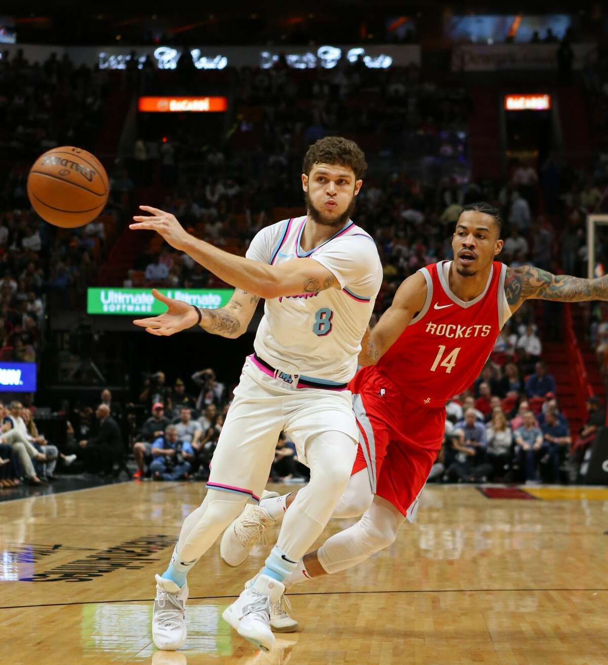 The Miami Heat's Tyler Johnson passes the ball away from the Houston Rockets' Gerald Green, right, during the first quarter at the AmericanAirlines Arena in Miami on Wednesday, Feb. 7, 2018. (David Santiago/El Nuevo Herald/TNS)