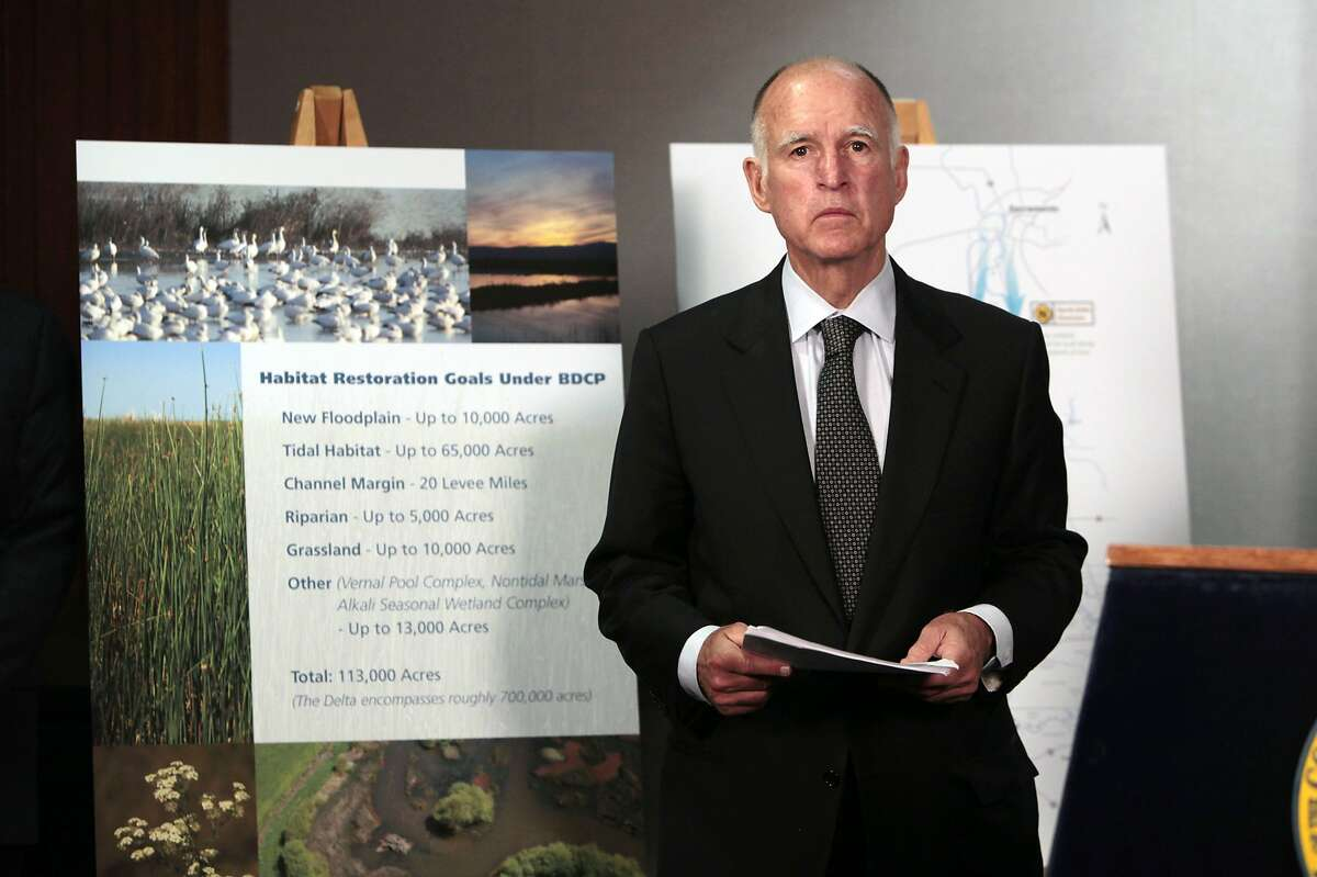 FILE - In this July 25, 2012 file photo, California Gov. Jerry Brown prepares to announce plans to build a giant twin tunnel system to move water from the Sacramento-San Joaquin River Delta to farmland and cities at a news conference in Sacramento. Brown is scaling back his troubled proposal for overhauling California's water system, at least for now. State official Karla Nemeth wrote Wednesday, Feb. 7, 2018 that the Brown administration is looking at building a single giant water tunnel now. California would build a second one later if the money is found for it. (AP Photo/Rich Pedroncelli, File)