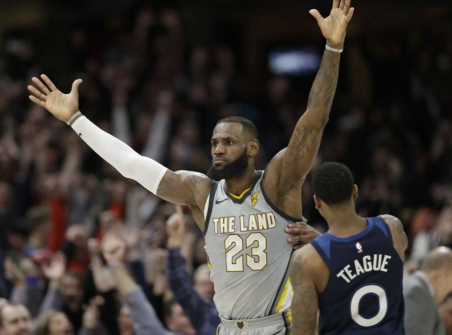 LeBron James celebrates after hitting a game-winning jumper in overtime as the Cavs beat the Timberwolves 140-138. Photo: Tony Dejak, Associated Press