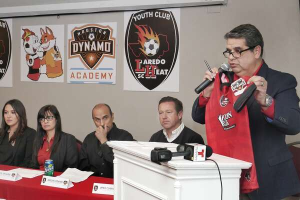 Heat owners Priya and Shashi Vaswani and James Clarkson of the Dynamo Youth Academy look on as Laredo general manager J.J. Vela speaks at a press conference Wednesday announcing a partnership between the clubs.