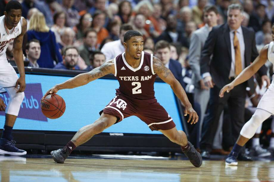 Texas A&M guard TJ Starks dibbles the ball during the first half of an NCAA college basketball game against Auburn on Wednesday, Feb. 7, 2018, in Auburn, Ala. (AP Photo/Brynn Anderson) Photo: Brynn Anderson/Associated Press