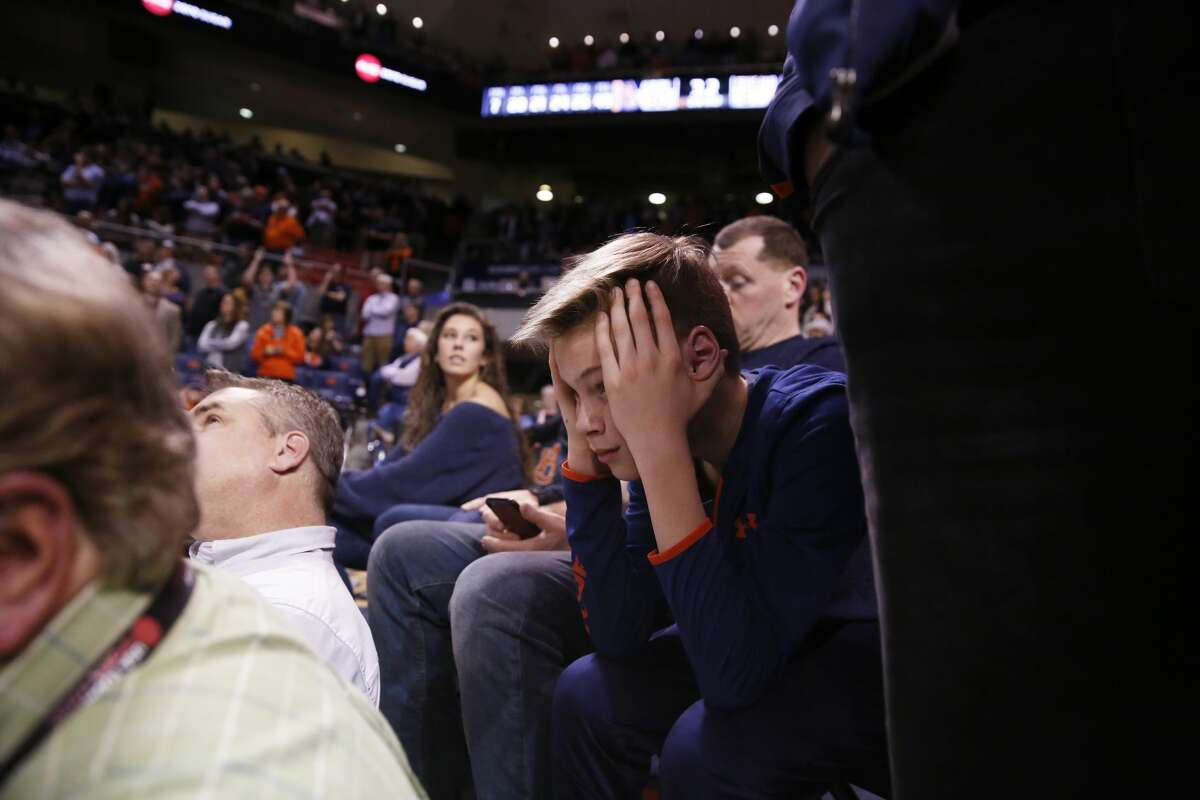 An Auburn fan reacts to the teams loss against Texas A&M during the second half of an NCAA college basketball game on Wednesday, Feb. 7, 2018, in Auburn, Ala. Texas A&M won 81-80. (AP Photo/Brynn Anderson)